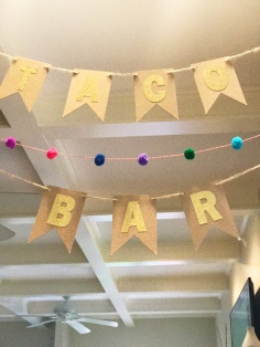 "Made the ""Taco Bar"" banner with glitter stickers, twine, and thick cardstock. Pom pom banner was found in the $1 section at Target!!"